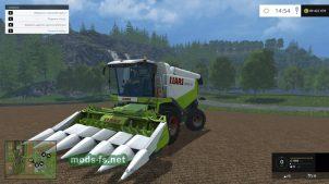 Комбайн и жатка для сбора кукурузы