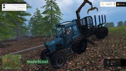 Трактор с погрузчиком и прицепом для деревьев