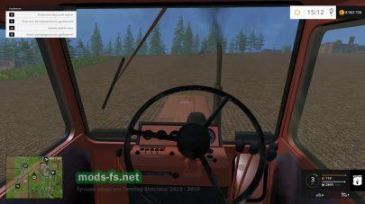 Внутри кабины трактора