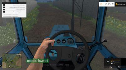 Водитель за рулем МТЗ
