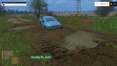Застрявшая в болоте машина