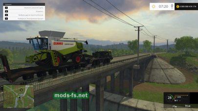 Трал для перевозки комбайнов в игре Farming Simulator 2015