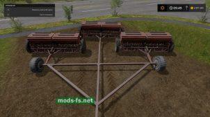 Три сеялки на сцепке в игре Фермер Симулятор 2017
